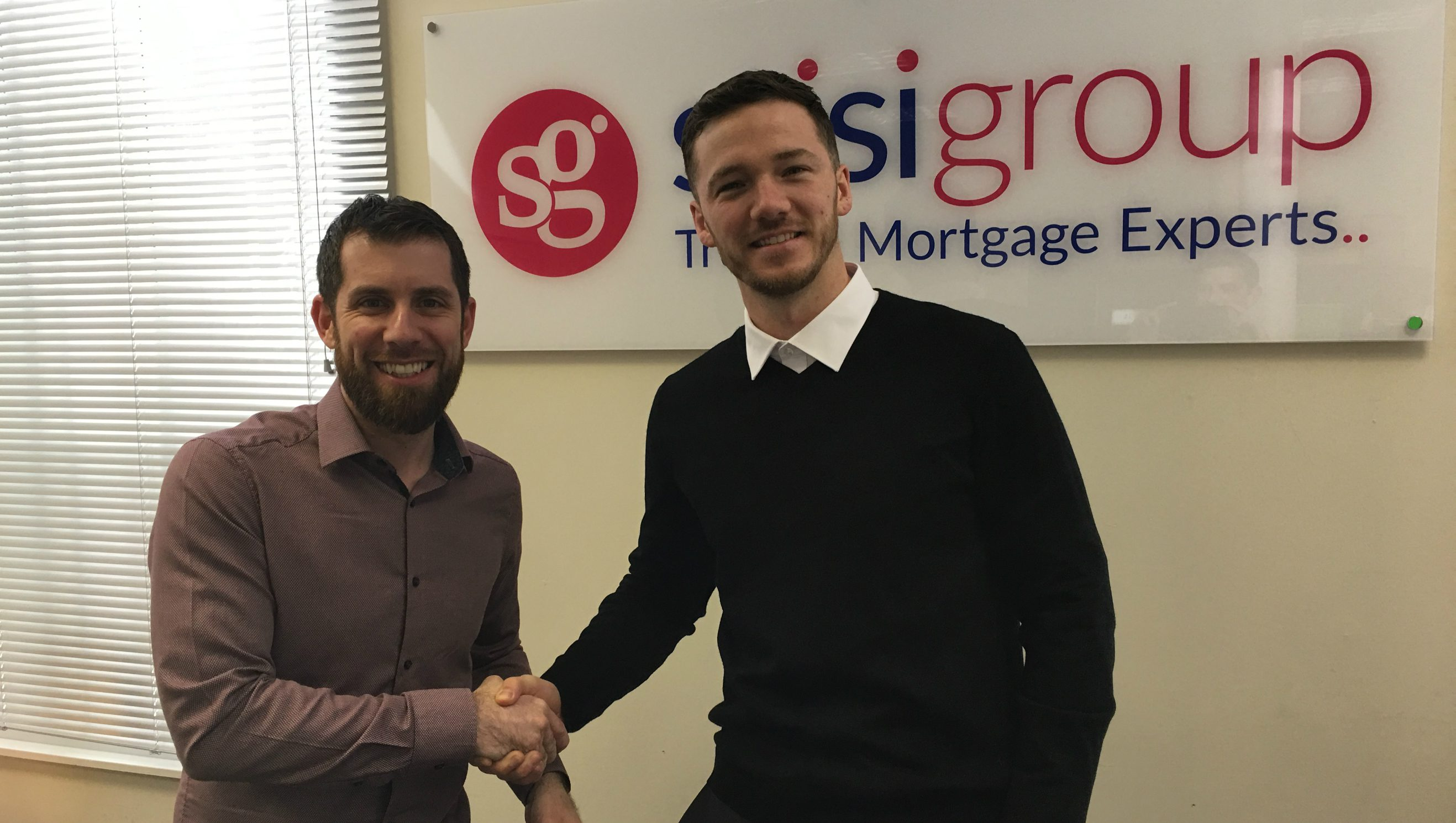 Managing Director Ross Stisi greets new team member Craig Spalding, on his first day with Stisi Group