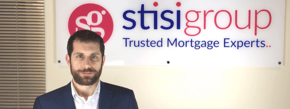 About Stisi Group - Ross Stisi in front of Stisi Group logo
